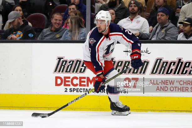 Cleveland Monsters defenceman Adam Clendening controls the puck during the first period of the American Hockey League game between the...