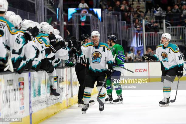 Cleveland Monsters defenceman Adam Clendening is congratulated by teammates after scoring the eventual game-winning goal with 1:44 left in the third...