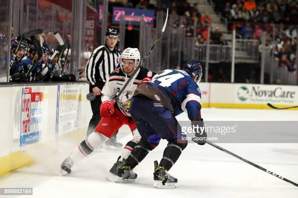 Cleveland Monsters defenceman Cameron Gaunce prepares to hip check Grand Rapids Griffins center Dominic Turgeon into the boards during the first...