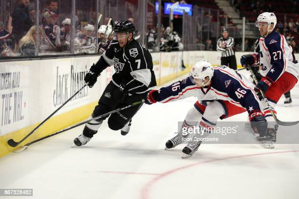 Cleveland Monsters defenceman Dean Kukan defends against Ontario Reign center Brett Sutter during the third period of the American Hockey League game...