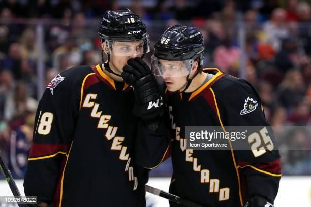 Cleveland Monsters defenceman Dillon Simpson and Cleveland Monsters center Alex Broadhurst discuss strategy before a faceoff during the second period...