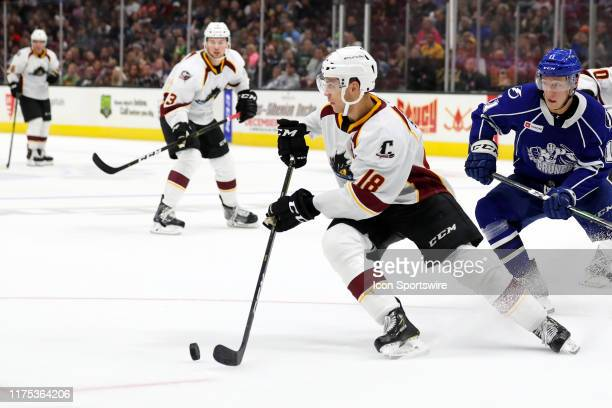 Cleveland Monsters defenceman Dillon Simpson controls the puck during the third period of the American Hockey League game between the Syracuse Crunch...