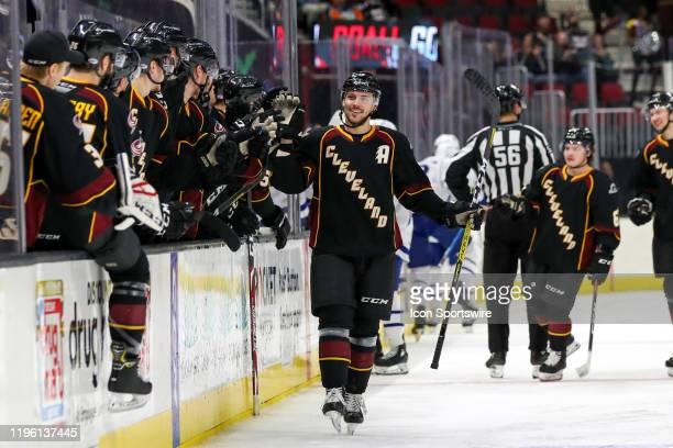 Cleveland Monsters defenceman Dillon Simpson is congratulated by teammates after scoring a goal during the first period of the American Hockey League...