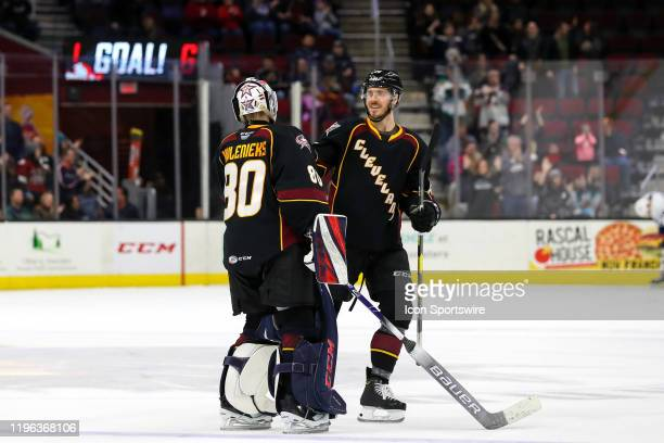 Cleveland Monsters defenceman Doyle Somerby and Cleveland Monsters goalie Matiss Kivlenieks celebrate following the American Hockey League game...