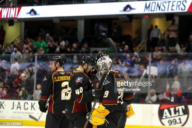 Cleveland Monsters defenceman Garret Cockerill and Cleveland Monsters goalie Brad Thiessen celebrate following the American Hockey League game...