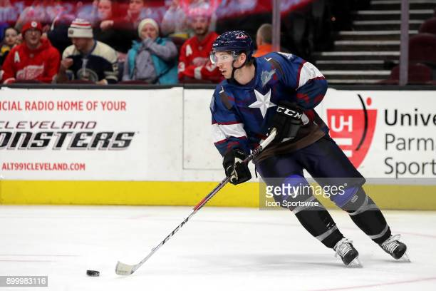 Cleveland Monsters defenceman John Ramage plays the puck during the first period of the American Hockey League game between the Grand Rapids Griffins...