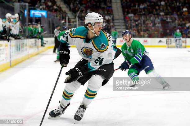 Cleveland Monsters defenceman Michael Prapavessis collects the puck during the first period of the American Hockey League game between the Milwaukee...