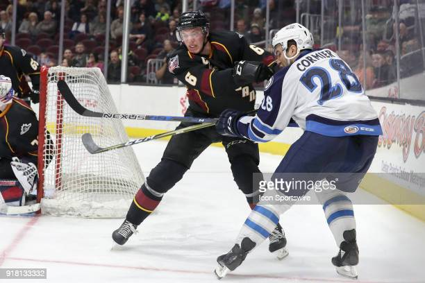 Cleveland Monsters defenceman Ryan Collins defends against Manitoba Moose center Patrice Cormier during the third period of the American Hockey...