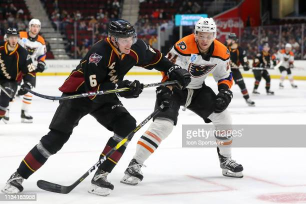Cleveland Monsters defenceman Ryan Collins is defended by Lehigh Valley Phantoms left wing Carsen Twarynski during the third period of the American...