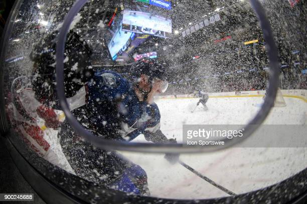 Cleveland Monsters defenceman Ryan Collins snows the photo hole as he stops along the boards during the third period of the American Hockey League...