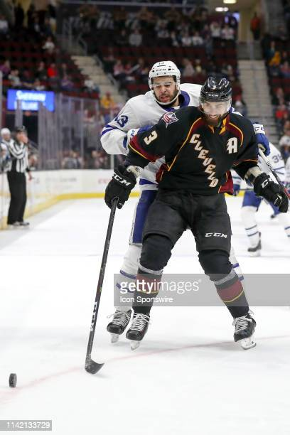 Cleveland Monsters defenceman Tommy Cross and Toronto Marlies right wing Nicholas Baptiste battle for the puck during the third period of the 2019...