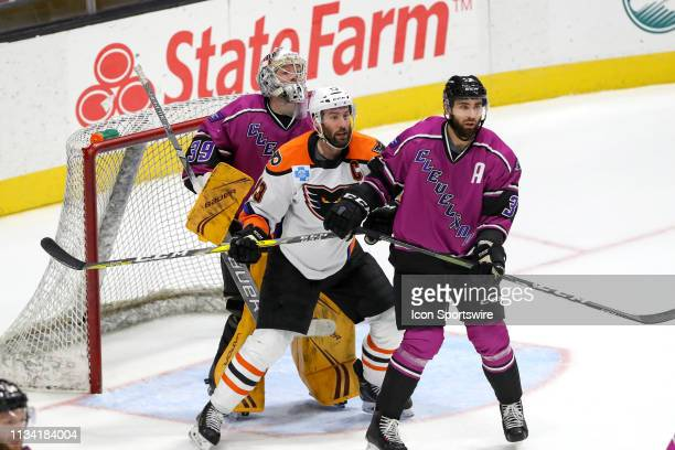 Cleveland Monsters defenceman Tommy Cross defends Lehigh Valley Phantoms right wing Colin McDonald in front of Cleveland Monsters goalie Brad...