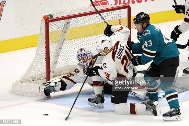 Cleveland Monsters defenseman Cameron Gaunce clears the puck ahead of San Jose Barracuda right wing Filip Sandberg as Cleveland Monsters goalie...