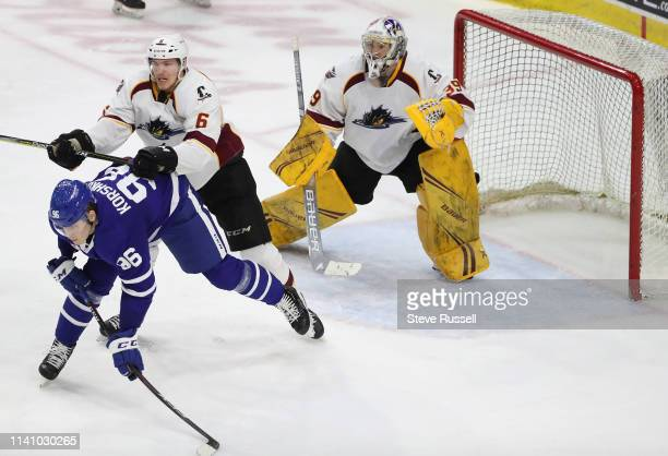 TORONTO ON MAY 3 Cleveland Monsters defenseman Ryan Collins tries to clear Toronto Marlies forward Egor Korshkov from in front of Cleveland Monsters...