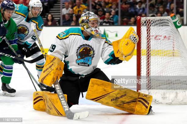 Cleveland Monsters goalie Brad Thiessen makes a glove save during the third period of the American Hockey League game between the Milwaukee Admirals...