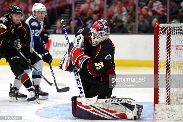 Cleveland Monsters goalie Jean-Francois Berube clutches the puck after making a save during the third period of the American Hockey League game...