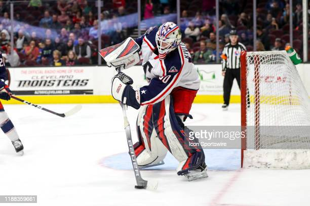 Cleveland Monsters goalie Matiss Kivlenieks clears the puck during the third period of the American Hockey League game between the...
