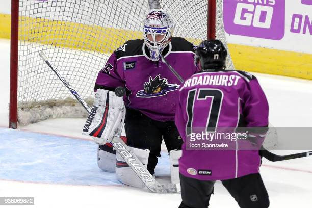 Cleveland Monsters goalie Matiss Kivlenieks faces a shot during overtime of the American Hockey League game between the San Diego Gulls and Cleveland...