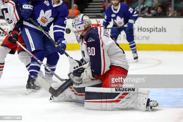 Cleveland Monsters goalie Matiss Kivlenieks gets a good look at the puck as he makes a save during the third period of the American Hockey League...