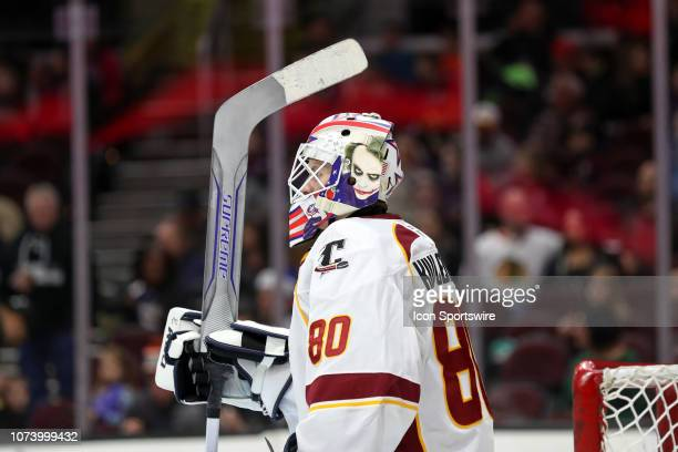 Cleveland Monsters goalie Matiss Kivlenieks in goal with a Jokerthemed goalie mask during the first period the American Hockey League game between...