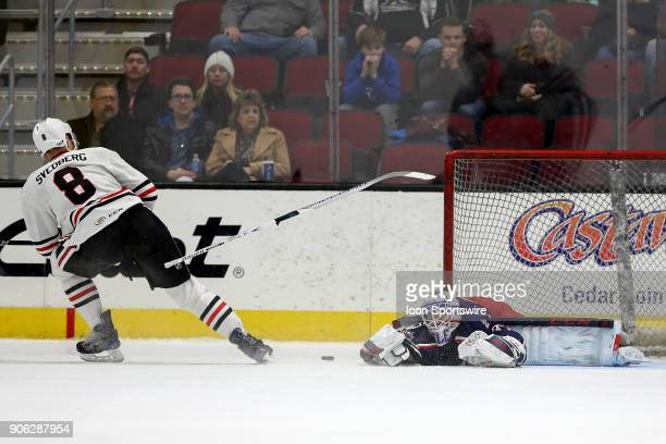 Cleveland Monsters goalie Matiss Kivlenieks looses his stick as he makes a save against Rockford IceHogs defenceman Viktor Svedberg during the...