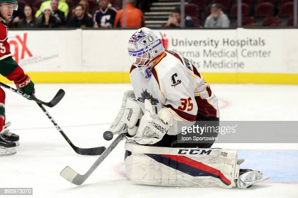 Cleveland Monsters goalie Matiss Kivlenieks makes a save during the third period of the American Hockey League game between the Iowa Wild and...