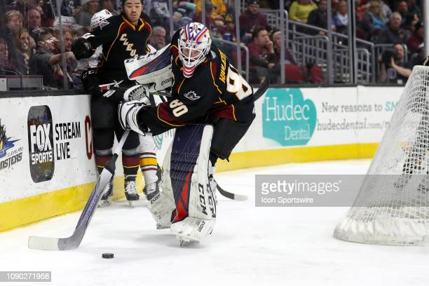 Cleveland Monsters goalie Matiss Kivlenieks plays the puck during the second period of the American Hockey League game between the Chicago Wolves and...