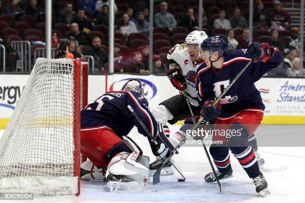Cleveland Monsters goalie Matiss Kivlenieks reaches for the puck as Cleveland Monsters defenceman Ryan Collins defends against Rockford IceHogs left...