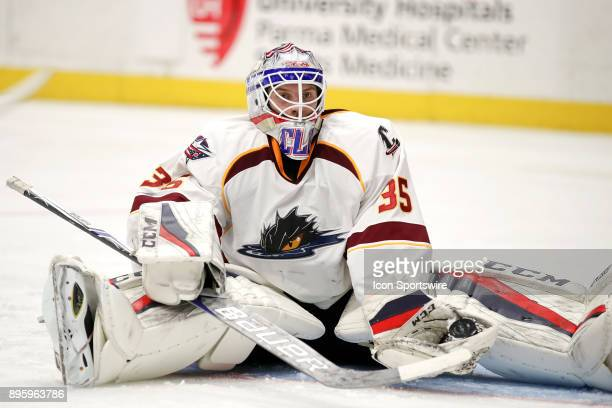 Cleveland Monsters goalie Matiss Kivlenieks sits on the ice after making a save during the third period of the American Hockey League game between...