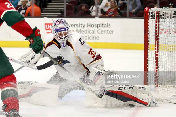 Cleveland Monsters goalie Matiss Kivlenieks with a pad save during the third period of the American Hockey League game between the Iowa Wild and...