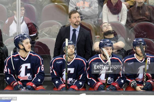 Cleveland Monsters head coach John Madden behind the bench during the second period of the AHL hockey game between the Iowa Wild and Cleveland...