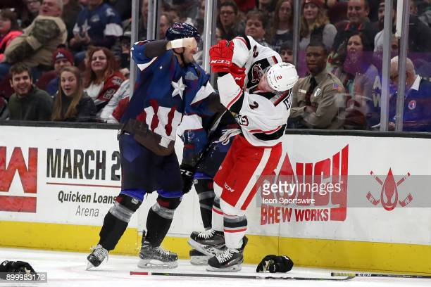 Cleveland Monsters left wing Brett Gallant fights Grand Rapids Griffins defenceman Joe Hicketts during the second period of the American Hockey...