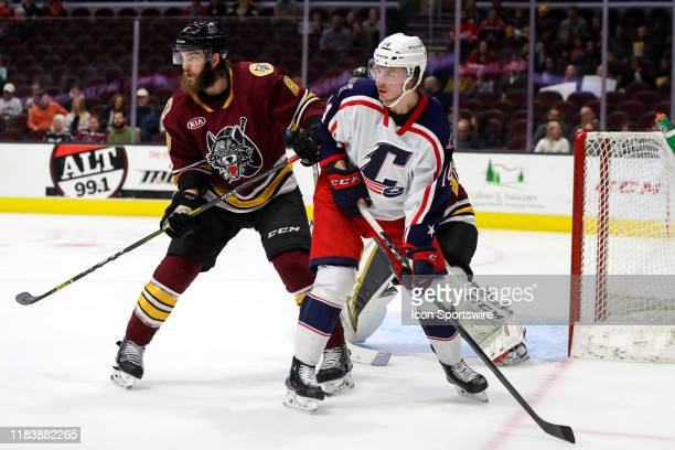 Cleveland Monsters left wing Jakob Lilja is defended by Chicago Wolves defenceman Brett Lernout during the second period of the American Hockey...