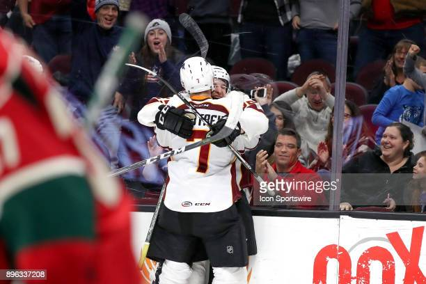 Cleveland Monsters left wing Nick Moutrey and Cleveland Monsters center Alex Broadhurst celebrate after Broadhurst scored the gamewinning goal in...