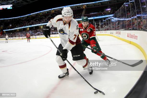 Cleveland Monsters left wing Nick Moutrey plays the puck as Iowa Wild defenceman Carson Soucy defends during the second period of the American Hockey...