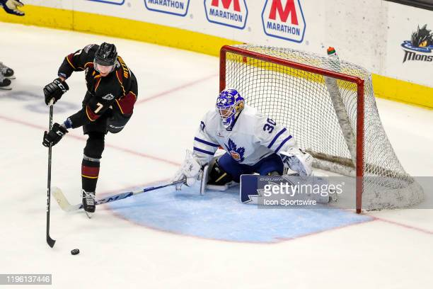 Cleveland Monsters left wing Paul Bittner plays the puck in front of Toronto Marlies goalie Kasimir Kaskisuo during the third period of the American...