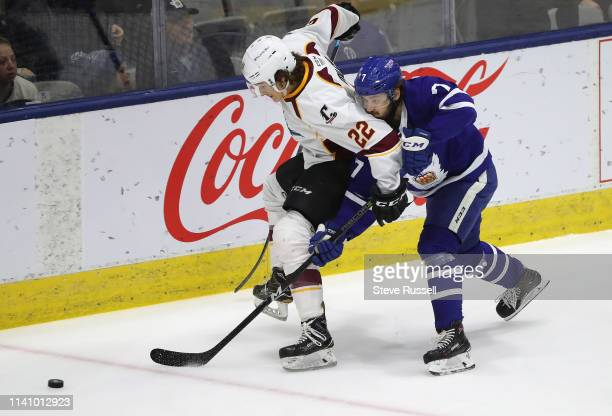 TORONTO ON MAY 3 Cleveland Monsters left wing Sonny Milano fights off Toronto Marlies defenseman Timothy Liljegren as the Toronto Marlies play the...