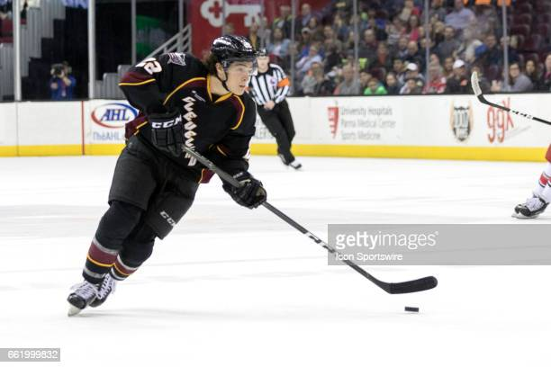 Cleveland Monsters LW Sonny Milano looks to shoot during the second period of the AHL hockey game between the Charlotte Checkers and Cleveland...