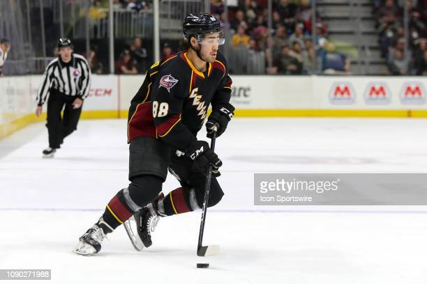 Cleveland Monsters right wing Kole Sherwood controls the puck during the second period of the American Hockey League game between the Chicago Wolves...