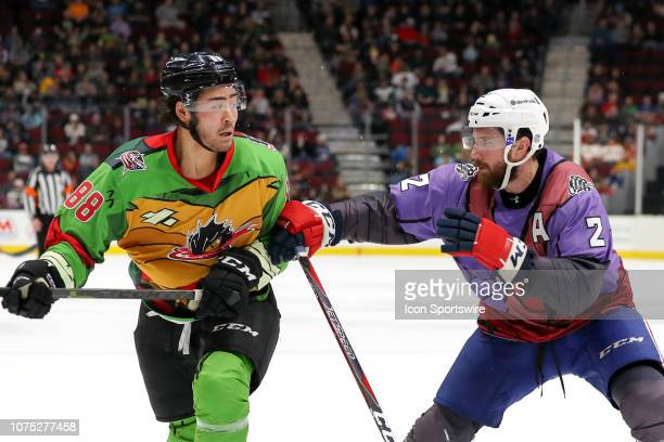 Cleveland Monsters right wing Kole Sherwood is defended by Rochester Americans defenceman Andrew MacWilliam during the second period of the American...