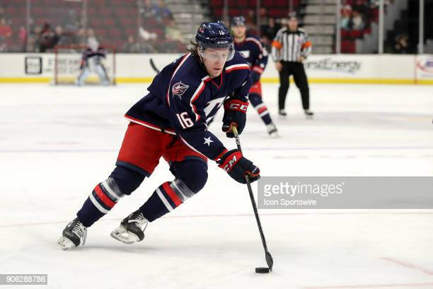 Cleveland Monsters right wing Miles Koules controls the puck during the second period of the American Hockey League game between the Rockford IceHogs...