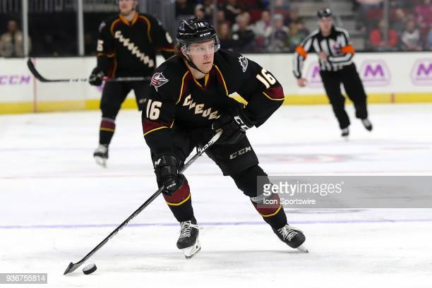 Cleveland Monsters right wing Miles Koules controls the puck during the second period of the American Hockey League game between the Chicago Wolves...