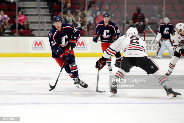 Cleveland Monsters right wing Miles Koules is defended by Rockford IceHogs defenceman Adam Clendening during the second period of the American Hockey...