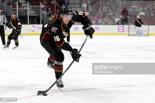 Cleveland Monsters right wing Miles Koules shoots the puck during the second period of the American Hockey League game between the Chicago Wolves and...