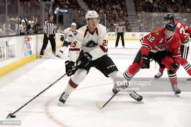 Cleveland Monsters RW Hayden Hodgson looks to shoot as Rockford IceHogs D Carl Dahlstrom defends during the second period of the AHL hockey game...