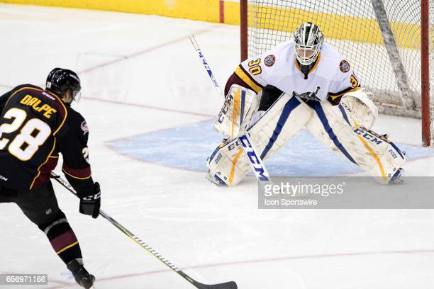 Cleveland Monsters RW Zac Dalpe looks to shoot against Chicago Wolves G Ville Husso during the third period of the AHL hockey game between the...