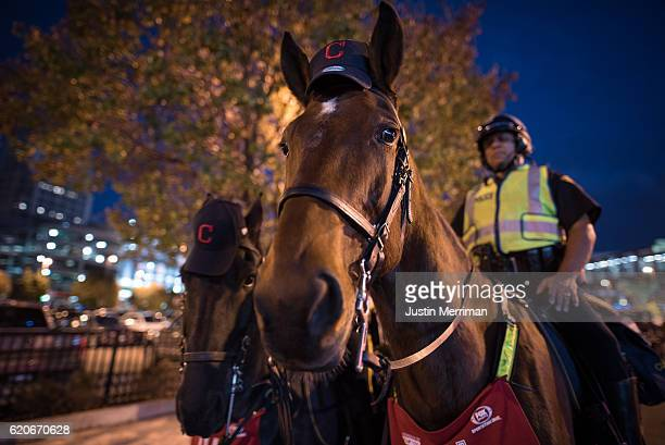 Cleveland Mounted Police keep watch near Progressive Field before the start of game 7 of the World Series between the Cleveland Indians and the...