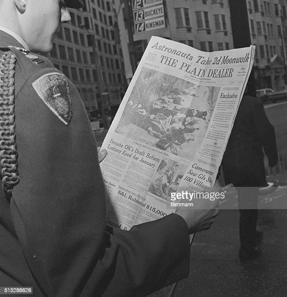 Cleveland, O.: An officer training candidate looks at copyrighted pictures by Ronald Haeberle which appeared in morning paper. Haeberle, a former...