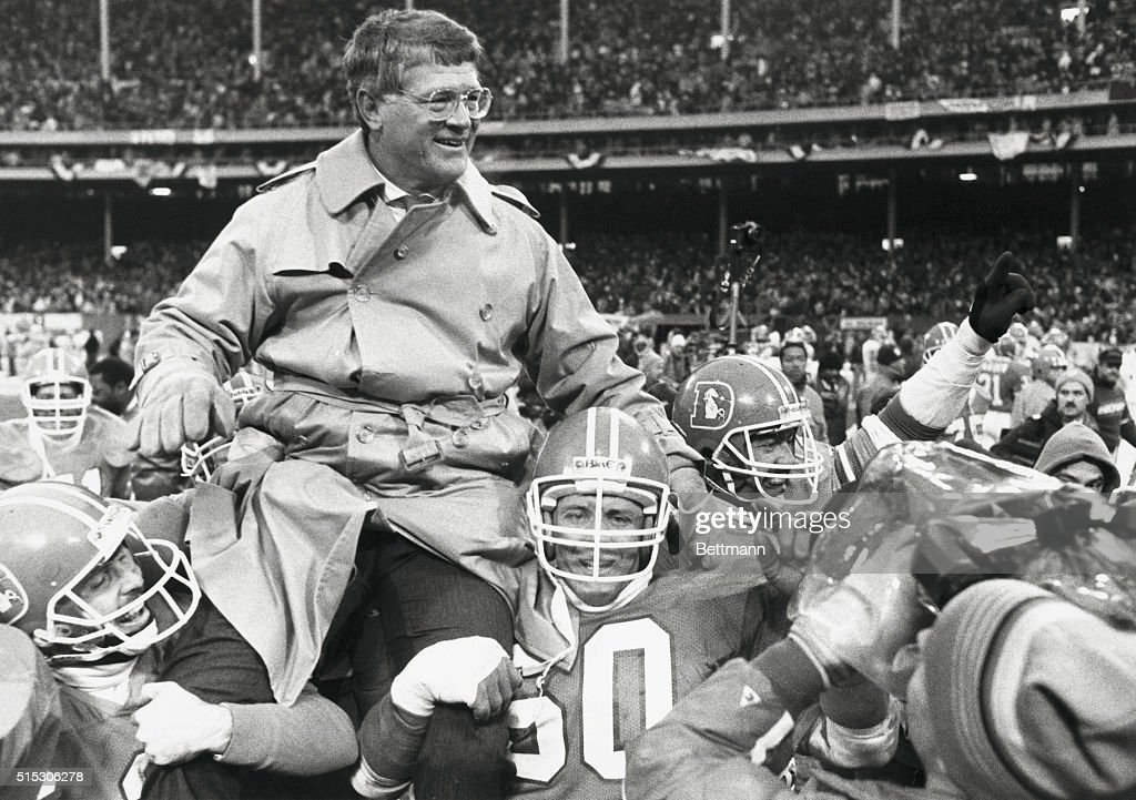 Players Carrying Dan Reeves After AFC Win : News Photo