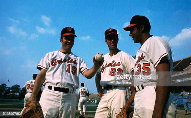 Pitching aces Mike Cuellar , Jim Palmer , and Dave McNally of the Baltimore Orioles baseball team, in uniform in a baseball stadium.